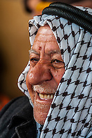 Jordanian man wearing keffiyeh drinking tea, Aqaba, Jordan