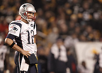 PITTSBURGH, PA - OCTOBER 30:  Tom Brady #12 of the New England Patriots looks on during a break in the game against the Pittsburgh Steelers during the game on October 30, 2011 at Heinz Field in Pittsburgh, Pennsylvania.  (Photo by Jared Wickerham/Getty Images)