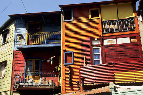 Buenos Aires, Argentina. Brightly painted wooden and corrugated iron houses in La Boca district.