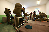 Young Polish soldiers packing up at their room on the way for the exercises at the range. Bartoszyce, Poland, May 2008<br /> (Photo by Piotr Malecki / Napo Images)<br /> Ostatni pobor.Wyjscie na poligon. Bartoszyce.5/2008<br /> Fot: Piotr Malecki / Napo Images