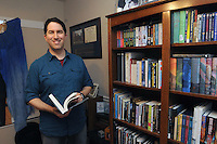 NWA Democrat-Gazette/FLIP PUTTHOFF <br /> Ryan Wells enjoys     April 12, 2016  spending time in his family's home library.