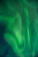 Northern Lights fill night sky, Lofoten Islands, Norway