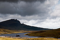Loch Fada with the Storr mountain ridge on background, Trotternish peninsula, Isle of Skye, Scotland. Visible is the well known pinnacle of the Old Man of Storr.