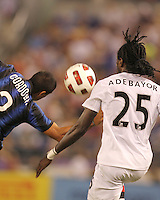 Ivan Cordoba #2 of Inter Milan heads the ball away from Emmanuel Adebayor #25 of Manchester City during an international friendly match on July 31 2010 at M&T Bank Stadium in Baltimore, Maryland. Milan won 3-0.