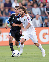 Santa Clara, California - Saturday July 14, 2012: Real Salt Lake's Kyle Beckerman and San Jose Earthquakes' Chris Wondolowski in action during a game at Buck Shaw Stadium, Stanford, Ca     San Jose Earthquakes defeated Real Salt Lake 5 - 0