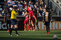 Kyle Beckerman (5) of Real Salt Lake celebrates scoring with teammates. Real Salt Lake and the Philadelphia Union played to a 2-2 tie during a Major League Soccer (MLS) match at PPL Park in Chester, PA, on April 12, 2014.