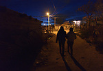 Patricia Esquivel and her daughter, Yarely Arellano, walk through the predawn darkness of the Mexican city of Juarez. They are on their way to the U.S. border, where Arellano will cross into El Paso, Texas, to study at the Lydia Paterson Institute, a United Methodist sponsored high school. Arellano makes the journey every school day, and most days her mother accompanies her to the border for safety. Arellano was born in the United States, and is thus a U.S. citizen, but her mother, a Mexican national, was later deported and is not allowed to reenter the U.S.