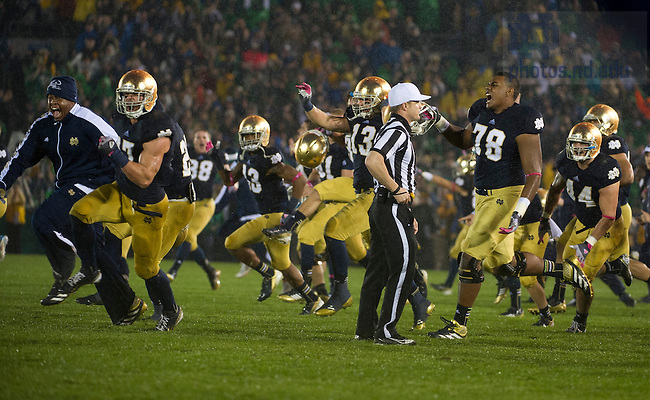 Oct. 13, 2012; Notre Dame players celebrate after defeating Stanford 20 to 13 in overtime. Photo by Barbara Johnston/University of Notre Dame