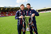 Lincoln City's assistant manager Nicky Cowley, left, and Lincoln City manager Danny Cowley poses for a photograph with with Vanarama National League trophy<br /> <br /> Photographer Chris Vaughan/CameraSport<br /> <br /> Vanarama National League - Lincoln City v Macclesfield Town - Saturday 22nd April 2017 - Sincil Bank - Lincoln<br /> <br /> World Copyright &copy; 2017 CameraSport. All rights reserved. 43 Linden Ave. Countesthorpe. Leicester. England. LE8 5PG - Tel: +44 (0) 116 277 4147 - admin@camerasport.com - www.camerasport.com