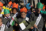 "Palestinian children hold paper ships reading in Arabic ""No to the siege"" during a rally to protest against the Israeli siege of the Gaza Strip on November 30, 2013 at Gaza City harbour. Photo by Ashraf Amra"