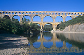Historic Pont du Gard and reflection, Gard River, France.