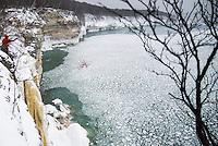 Ice climbing along the coast of Lake Superior at Pictured Rocks National Lakeshore on Michigan's Upper Peninsula near Munising, Michigan USA.