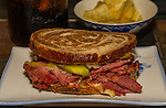Reuben sandwich is an American hot sandwich composed of corned beef, Swiss cheese, sauerkraut, pickle and Russian or Thousand Island dressing, grilled between slices of rye bread. ©2016. Jim Bryant Photo. All Rights Reserved.