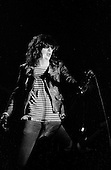 Denver, Colorado<br /> USA<br /> May 9, 1983<br /> <br /> Front-man and Ramones singer: Joey Ramone in concert.<br /> <br /> The Ramones were an American rock band that formed in Forest Hills, Queens, New York in 1974, often cited as the first punk rock group. Despite achieving only limited commercial success, the band was a major influence on the punk rock movement both in the United States and the United Kingdom.<br /> <br /> All of the band members adopted pseudonyms ending with the surname &quot;Ramone&quot;, though none of them were actually related. They performed 2,263 concerts, touring virtually nonstop for 22 years. In 1996, after a tour with the Lollapalooza music festival, the band played a farewell show and disbanded.<br /> <br /> By a little more than eight years after the breakup, the band's three founding members--lead singer Joey Ramone, guitarist Johnny Ramone, and bassist Dee Dee Ramone--had all died.