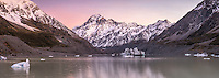 Pastel colours of dawn at Hooker Lake with icebergs and Aoraki,Mount Cook in background, Aoraki, Mt. Cook National Park, Mackenzie Country, UNESCO World Heritage Area, South Island, New Zealand, NZ