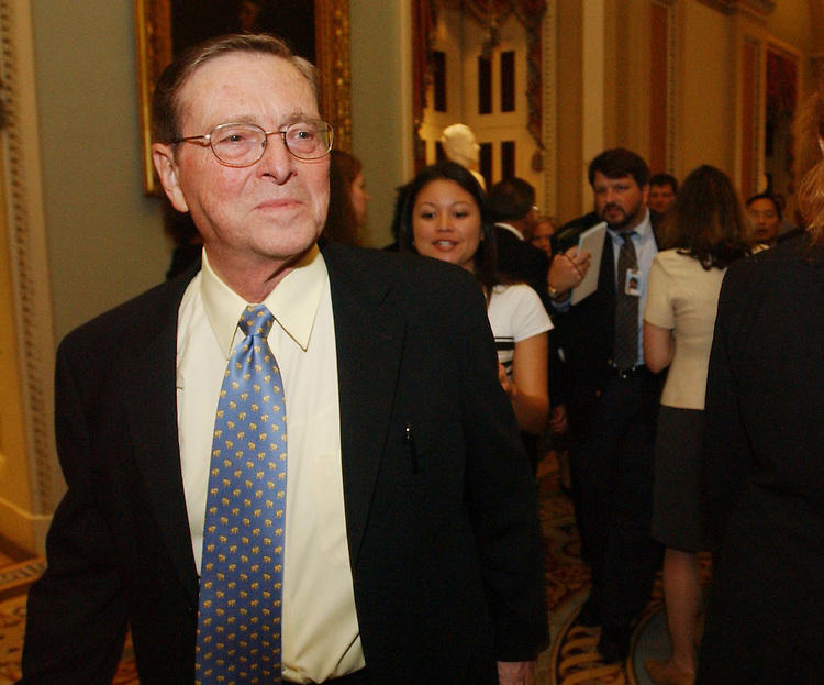 11/4/03.SENATE GOP LUNCHEON--As Senate Energy Chairman Pete V. Domenici, R-N.M., leaves the Senate GOP luncheon, he is spotted and pursued by reporters..CONGRESSIONAL QUARTERLY PHOTO BY SCOTT J. FERRELL