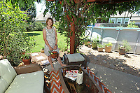 NWA Democrat-Gazette/MICHAEL WOODS &bull; @NWAMICHAELW<br /> Vanessa Ryerse  June 28, 2016 in her favorite space on her back porch in Springdale.