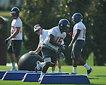 Ole Miss' Joel Kight (15) goes through a drill at  football practice in Oxford, Miss. on Sunday, August 7, 2011.