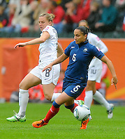 Amy Rodriguez (l) of team USA and Ophelie Meilleroux of team France during the FIFA Women's World Cup at the FIFA Stadium in Moenchengladbach, Germany on July 13th, 2011.