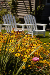 Yellow daisies and lawn chairs brighten a front lawn in Jacksonville, Oregon