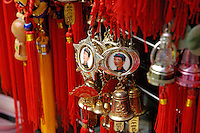Mao Zedong medals hanging in a souvenir stall outside Behai Park, Beijing, China.
