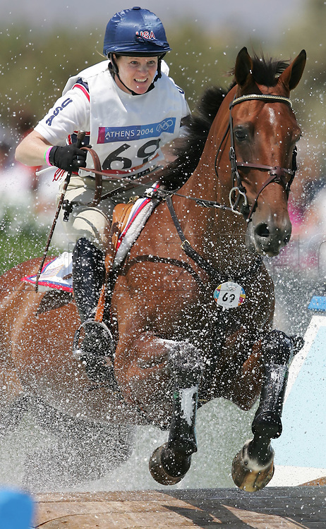 8/17/04 --Al Diaz/Miami Herald/KRT--Athens, Greece--Cross Country at the Equestrian Olympic Centre Markopoulo during the Athens 2004 Olympic Games. Kimberly Severson of the USA at the water jump riding Winsome Adante. Severson is ranked number three at 36.20.