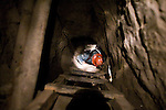 Descending a vertical shaft in La Negra mine.