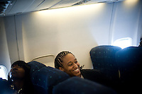 SAN JOSE, CA - MARCH 31, 2011: Melanie Murphy laughs with her teammates before takeoff en route to the NCAA Final Four at the San Jose International Airport on March 31, 2011.