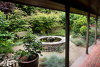 Secluded back yard courtyard garden room with raised circular fountain in California  garden, Schino