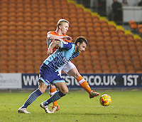 Blackpool's Mark Cullen battles with Wycombe Wanderers' Max Muller<br /> <br /> Photographer Alex Dodd/CameraSport<br /> <br /> Checkatrade Trophy Round 3 Blackpool v Wycombe Wanderers - Tuesday 10th January 2017 - Bloomfield Road - Blackpool<br />  <br /> World Copyright &copy; 2017 CameraSport. All rights reserved. 43 Linden Ave. Countesthorpe. Leicester. England. LE8 5PG - Tel: +44 (0) 116 277 4147 - admin@camerasport.com - www.camerasport.com