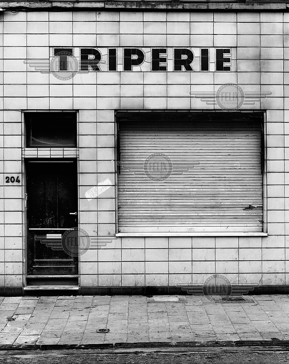 The shopfront of a Triperie, a shop selling tripe.