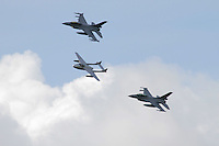 Two Norwegian F-16 in Formation with a DH Vampire during Tiger Air show.  Nato Tiger Meet is an annual gathering of squadrons using the tiger as their mascot. While originally mostly a social event it is now a full military exercise. Tiger Meet 2012 was held at the Norwegian air base &Oslash;rlandet.