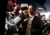 United States President Barack Obama (R) talks with Ollie Hayes, (L) and Henry Healy (C) as he visits a bar in celebration of St. Patrick's day at the Dubliner Restaurant and Pub on March 17, 2012 in Washington, DC. Next week, Obama and Vice President Biden will meet the Irish Prime Minister Enda Kenny and attend a St. Patrick's Day lunch at the Capitol..Credit: Joshua Roberts / Pool via CNP
