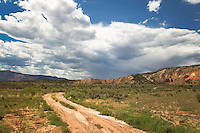 dirt road in Abiquiu, New Mexico and a dramatic sky
