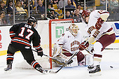 Steve Silva (Northeastern - 17), John Muse (BC - 1), Jimmy Hayes (BC - 10) - The Boston College Eagles defeated the Northeastern University Huskies 5-4 in their Hockey East Semi-Final on Friday, March 18, 2011, at TD Garden in Boston, Massachusetts.