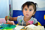 Melani Jovanna Mendez Rios paints during a session of the early intervention program of Piña Palmera, a center for community based rehabilitation for people living with disabilities in Zipolite, a town in Oaxaca, Mexico. The 2-year old girl lives with some physical disability.