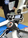 May 30, 2012, Tokyo, Japan - A handy mobile device for a bicycle featuring the global positioning system in a third-generation cellular phone module is demonstrated on the opening day of the Wireless Japan 2012, Japans biggest showcase of wireless and mobile technologies and solutions, in Tokyo on Wednesday, May 30, 2012. Some 180 companies participated in the three-day event, which the organizer expected to draw more than 50,000 visitors. (Photo by Natsuki Sakai/AFLO) AYF -mis-