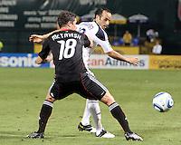 Devon McTavish #18 of D.C. United holds up Landon Donavon #10 of the Los Angeles Galaxy during an MLS match at RFK Stadium on July 18 2010, in Washington D.C. Galaxy won 2-1.