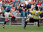 Stale Stensaas shoots past Seib Dykstra in the Dundee Utd goal and into the stand