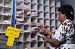 A U.S. Postal Service worker sorts mail destined for the White House at the Brentwood postal facility in 1989.