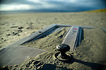Discarded door on Dollymount strand, Bull Island, Dublin, two weeks after I first photographed it...Bull Island is a UNESCO protected biosphere reserve in the Northern suburbs of Dublin. It features two golf clubs, and Dollymount beach, used for kitesurfing and other outdoor activities. Wildlife includes seals and bird life.