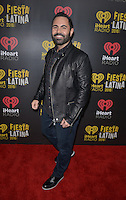 MIAMI, FL - NOVEMBER 05: Enrique Santos attends iHeartRadio Fiesta Latina at American Airlines Arena on November 5, 2016 in Miami, Florida.Credit: MPI10 / MediaPunch