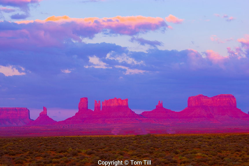 Monument Valley Tribal Park, Utah             The Bear, Stagecoach, and other pinnacles      Sunrise