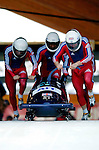 20 November 2005: Lee Johnston leads the Great Britain 1 sled pushoff in the first run of the 2005 FIBT AIT World Cup Men's 4-Man Bobsleigh Tour, piloting the team to a 20th place finish at the Verizon Sports Complex, in Lake Placid, NY. Mandatory Photo Credit: Ed Wolfstein.