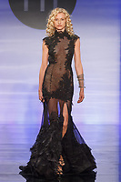 Model walks runway in an outfit by Julia Cork, during the Future of Fashion 2017 runway show at the Fashion Institute of Technology on May 8, 2017.