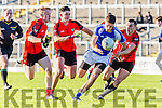 Templenoe star Adrian Spillane drives upfield past the swarm of Kenmare'sjohn Kevin O'Sullivan, Mark Foley and Mark Crowley during the County Intermediate Championship final in Fitzgerald Stadium on Sunday