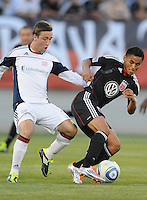 DC United midfielder Andy Najar (14) shields the ball against New England Revolution midfielder Ryan Kinne (35)  The New England Revolution defeated DC United 3-2 in US Open Cup match , at the Maryland SoccerPlex, Tuesday  April 26, 2011.