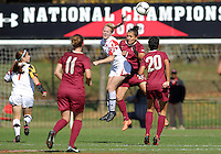 COLLEGE PARK, MD - OCTOBER 21, 2012:  Olivia Wagner (11) of the University of Maryland heads away from Marta Bakowska-Mathews (21) of Florida State during an ACC women's match at Ludwig Field in College Park, MD. on October 21. Florida won 1-0.