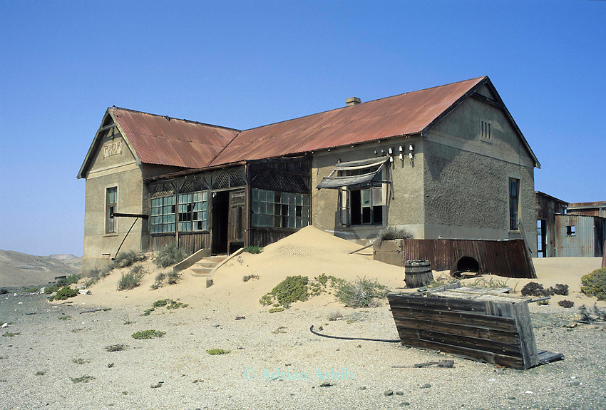 An abandoned mine workers house, Pomona, in the diamond region of the Namib Desert.  Namibia. Southern restricted Diamond region.