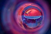 """Beauty at the Bottom: Tequila 6"" - This image is a photograph of a tequila bottle looking right down the mouth of the bottle."